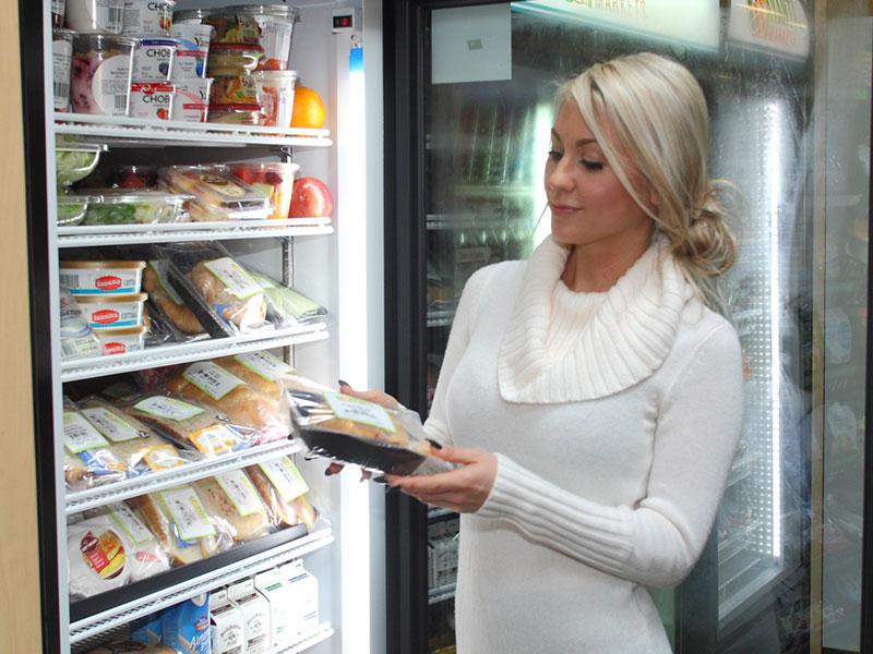 Woman purchasing a sandwich in an office micro-market
